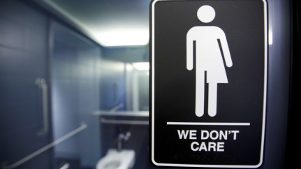A sign protesting a recent North Carolina law restricting transgender bathroom access in Durham, North Carolina